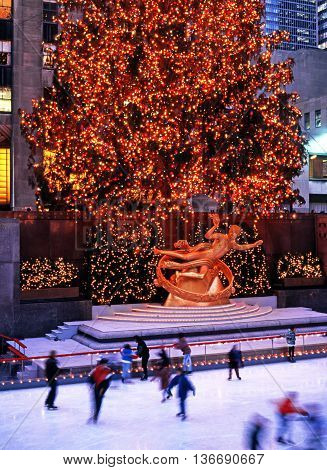 NEW YORK - DECEMBER 9, 1994 - Ice rink and Prometheus statue in the Rockefeller Plaza at Christmas New York USA, December 9, 1994.