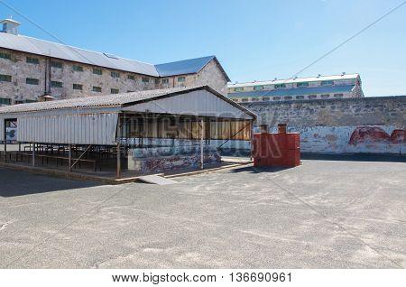 FREMANTLE,WA,AUSTRALIA-JUNE 1,2016:  Fremantle Prison yard with shelter under a clear blue sky in Fremantle, Western Australia.