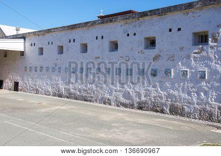 FREMANTLE,WA,AUSTRALIA-JUNE 1,2016:  Numbered exterior painted limestone wall at the Fremantle Prison in Fremantle, Western Australia.