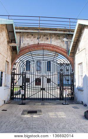 FREMANTLE,WA,AUSTRALIA-JUNE 1,2016:  View through the gate house's arched gateway at the Fremantle Prison in Fremantle, Western Australia.