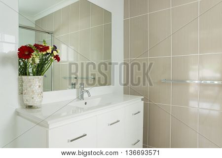 New compact ensuite bathroom with tiled walls and vanity