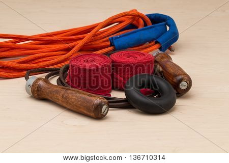 Sports equipment for boxing. Boxing bandages expander multiple fiber and leather jump rope on light background