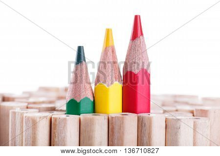 Three Sharpened Green,yellow,red Pencil Among Many Ones