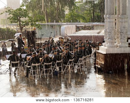 MOSCOW. RUSSIA - May 28, 2016: Military brass band perform during a shower. Central Avenue in the Park of VDNH Moscow. International Military Music Festival