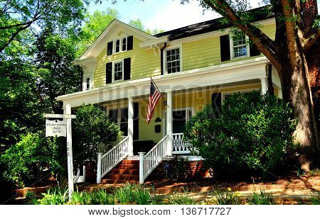 Hillsborough North Carolina - April 20 2016: c. 1786 William Whitted House with central entry staircase and expansive porch *