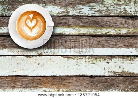 Top View Latte Art Coffee On Wood Background..