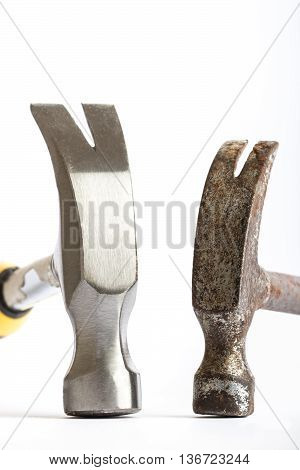 Two hammers one old one new on a white background