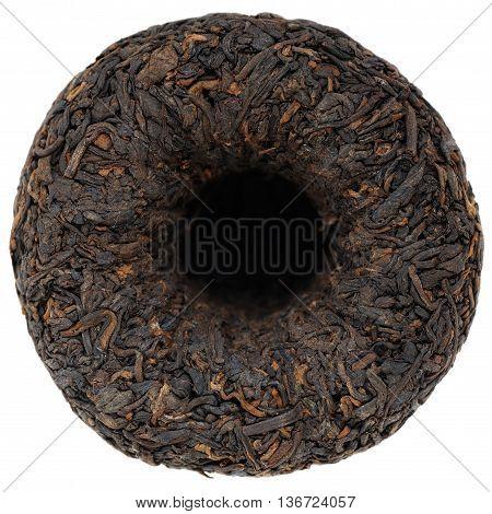 Ripe black puerh tea bowl shape tuo cha closeup isolated