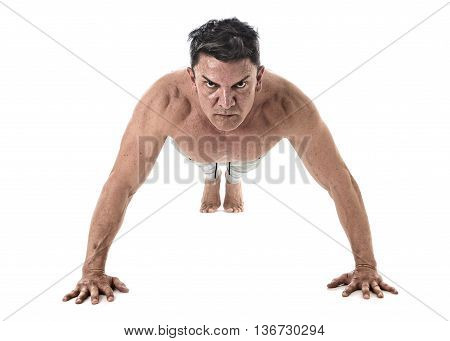 40 to 45 years old attractive fit man doing push up workout training hard fitness routine with strong muscular body isolated on white background in health sport and bodybuilding concept