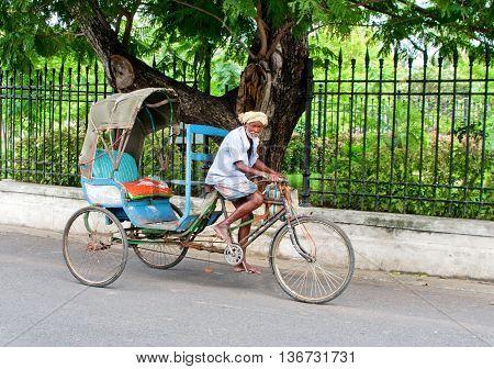 Old Indian  Rickshaw Man  In Pondicherry, India