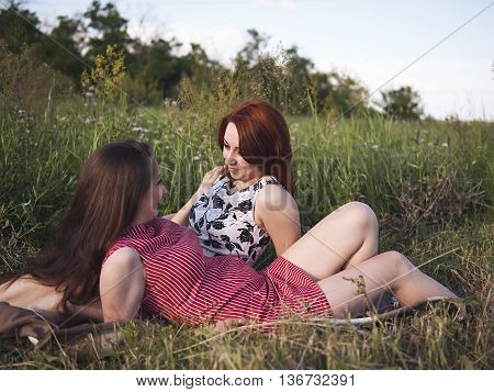 Two young girls on a rest outdoors