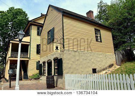 Old Salem North Carolina - April 21 2016: 1825 A. Buntner Hat Shop on Main Street