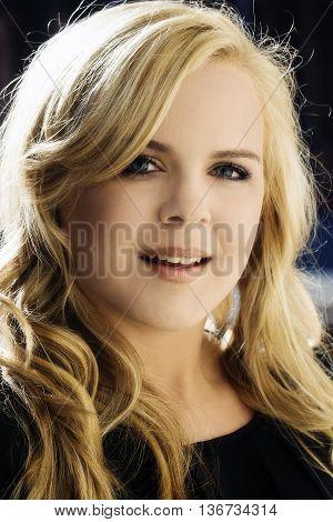 Attractive Blond Caucasian Woman Smiling Portrait Outdoors