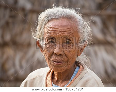 BAGAN MYANMAR - JANUARY 21 2016: Unidentified old woman who participated in the donation channeled ceremony Shinbyu marking the samanera ordination of a boy under the age of 20
