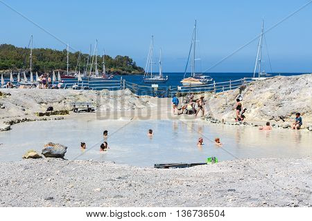 VULCANO ITALY - MAY 24: People relaxing in healthy mud pool on May 24 2016 at Aeolian Islands near Sicily Italy