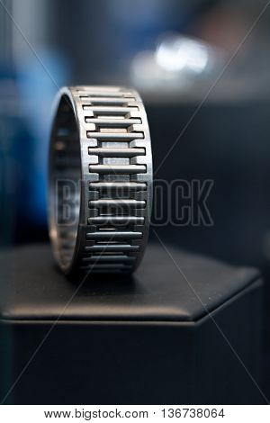 Metal modern cylindrical bearing with bokeh background