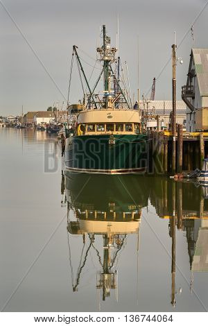 Steveston Fishboat. Morning light on boats tied up and in Steveston's harbour. A small fishing village on the banks of the Fraser River near Vancouver, British Columbia, Canada.