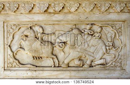 Detail of carved relief at Gatore Ki Chhatriyan in Jaipur Rajasthan India.