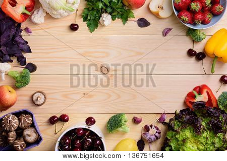 Vegetable and fruit food background. Organic healthy vegetarian foods. Farmers market layout. Copy space, top view.