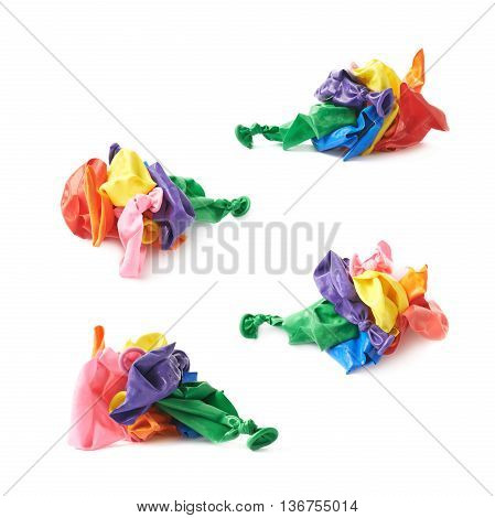 Pile of colorful burst blown up air balloons isolated over the white background, set collection of four different foreshortenings