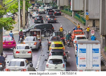 BANGKOK THAILAND - MAY 24 2016: Traffic moves slowly along a busy road the heavily congested in Bangkok Thailand