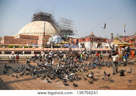 KATHMANDU NEPAL - APRIL 18 2016 : Boudhanath stupa under reconstruction after the earthquake on 25 April 2015 Boudhanath is one of famous place in Nepal and the largest ancient stupa in the world.