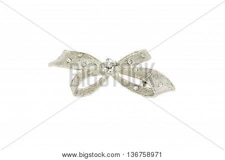 brooch in the shape of a bow isolated on a white background