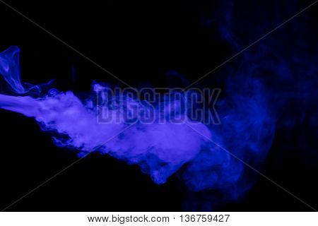 Abstract art. Blue smoke hookah on a black background. Inhalation. The steam generator. The concept of poison gas. Gas.