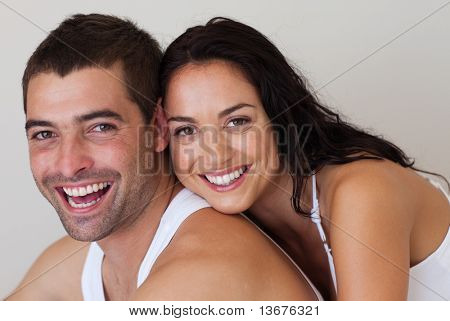 Young Smiling Romantic Couple relaxing in each others Company