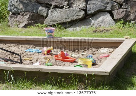 a kids sand box filled with toys