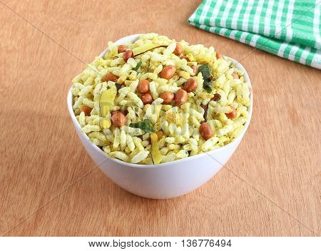 Spicy puffed rice, a popular and traditional Indian snack, in a bowl.