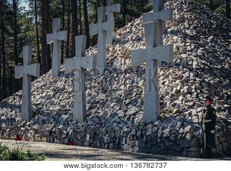 Kiev Ukraine - April 9 2015. Soldiers stands on guard next to monument at Bykivnia Graves near Kiev