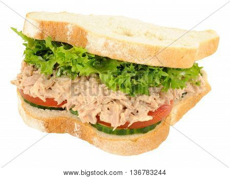 Tuna and salad filled sandwich in thick white sliced bread isolated on a white background