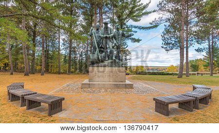OSCODA MI/USA - OCTOBER 14 2015: Pine needles decorate Lumberman's Monument, on the Highbanks Trail, on the AuSable Scenic Byway, in the Huron National Forest, near Oscoda, Michigan.