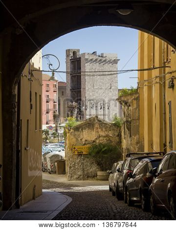 CAGLIARI, ITALY - March 31, 2015: Walk in the Castello district, in the background you can see the Tower of the Elephant - Sardinia