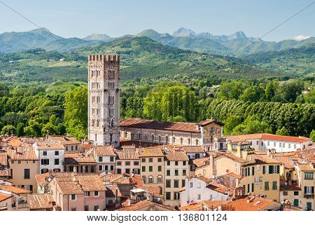 Aerial view of Lucca in Tuscany during a sunny afternoon; the bell tower belongs to the San Frediano church