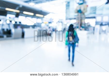 Blurred Background : Woman Traveler Walk In To Terminal At Airport Terminal Departure Blur Backgroun