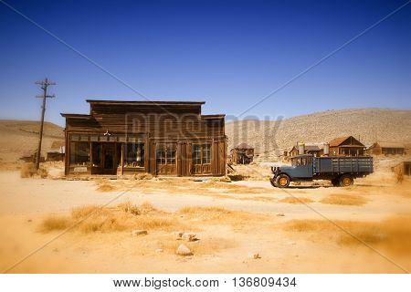 old wooden house and truck in Bodie ghost town in California