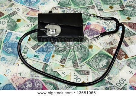 Stethoscope medical  on polish banknote money background