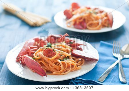 delicious cooked Italian pasta with a sauce of lobster