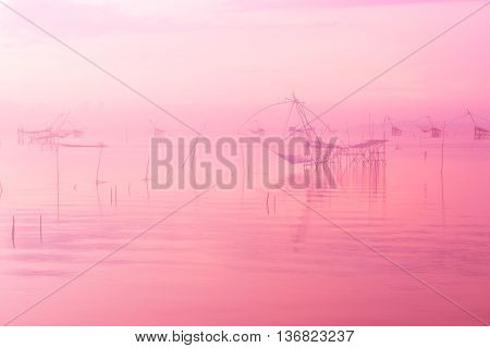 Scenery of large local fishing trap in the sea, pastel color with selective focus and soft, Thai old traditional equipment style fishing trap make with bamboo frame and fish net dipping