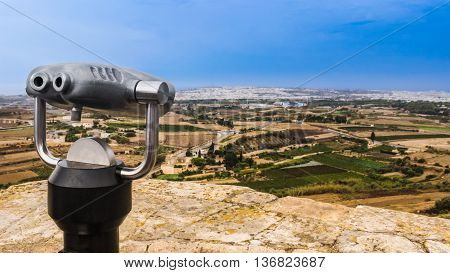 View point with binoculars for sightseeing from the highest point of the city in Mdina Malta