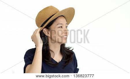 Casual friendly asian girl wearing hat relaxing and smiling on white background
