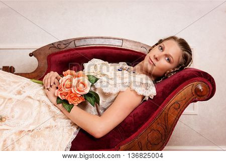 Victorian woman with flowers on fainting couch
