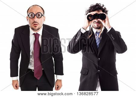 two businessman one with thick glasses and one with a binocular isolated over a white background