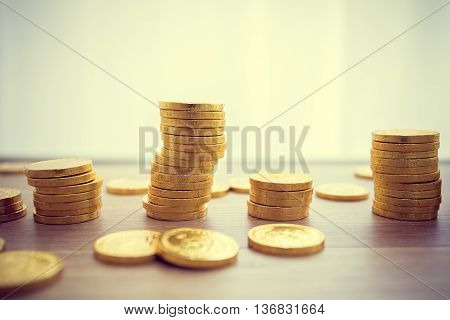 golden coins concept on a wood table. Taxpayer business concept