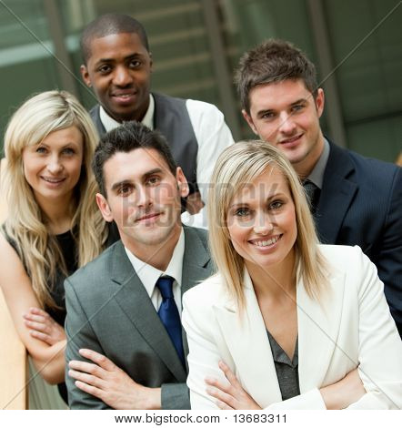 Businesspeople with a blon woman in the middle in an office