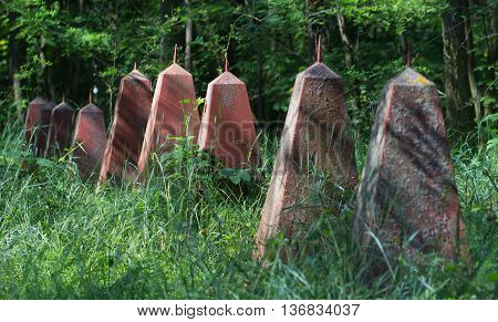Old red graves of Soviet soldiers in the field