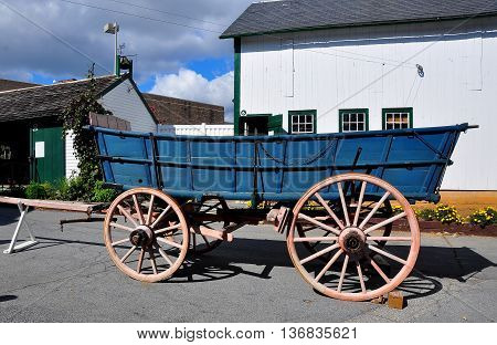 Lancaster Pennsylvania - October 18 2015: Wooden Amish farm wagon with large wheels at the Amish Farm and House Museum *