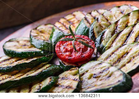 Grilled Zucchini Tomato with chili pepper. Italian mediterranean or greek cuisine. Vegan vegetarian food.